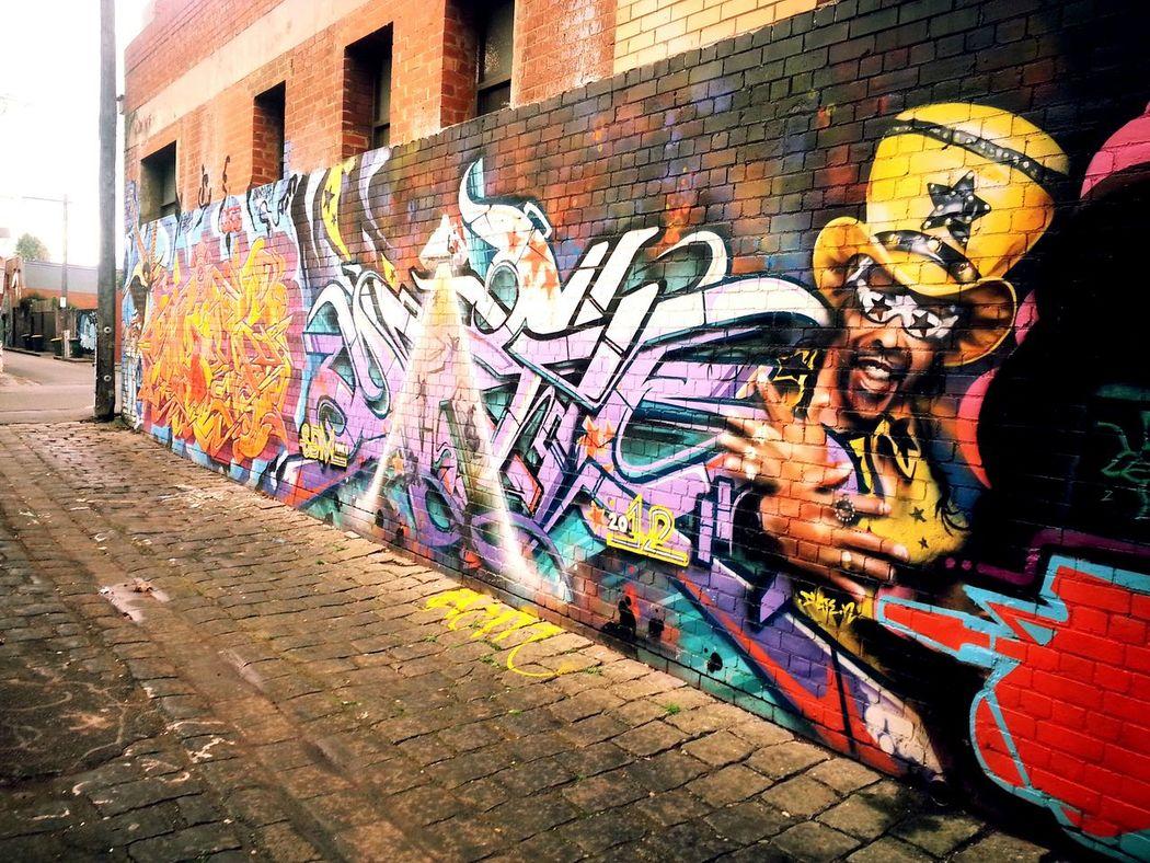 Graff sprawled along blue stone lane