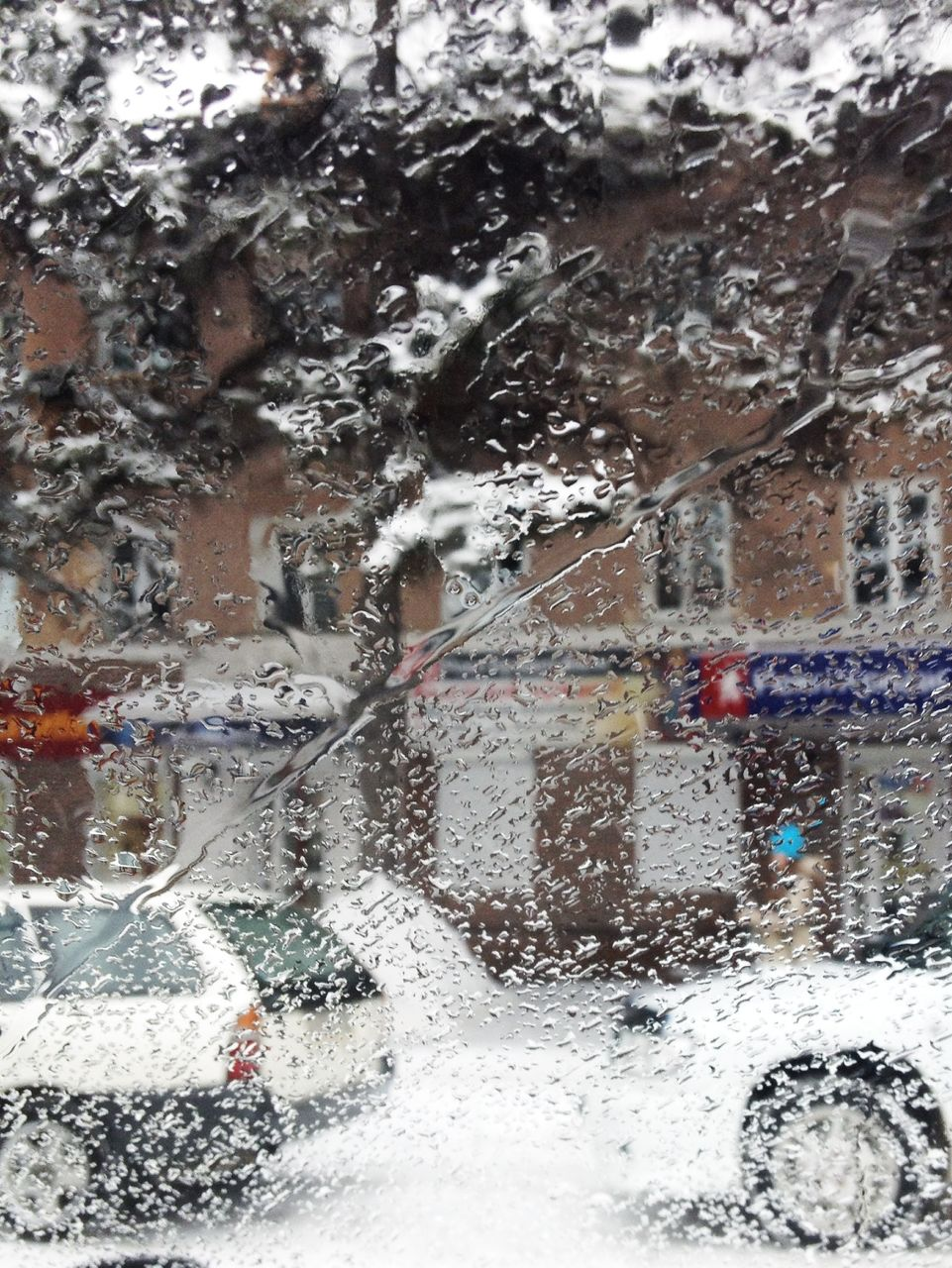 car, transportation, land vehicle, mode of transport, car wash, motion, road, day, outdoors, water, no people, snow, city, architecture, close-up
