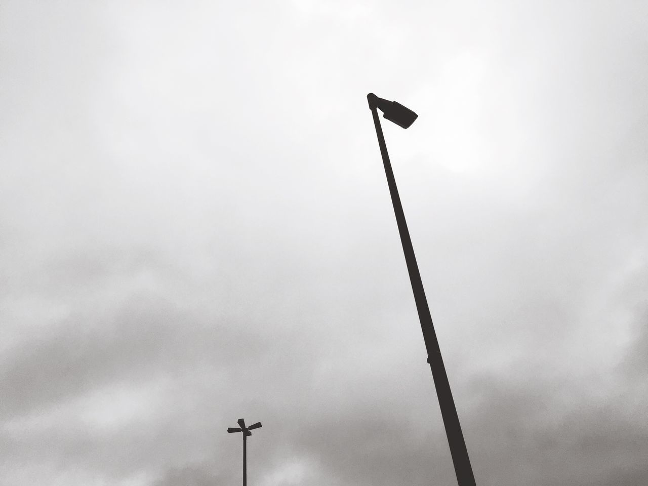 low angle view, street light, sky, floodlight, outdoors, no people, cloud - sky, day, technology