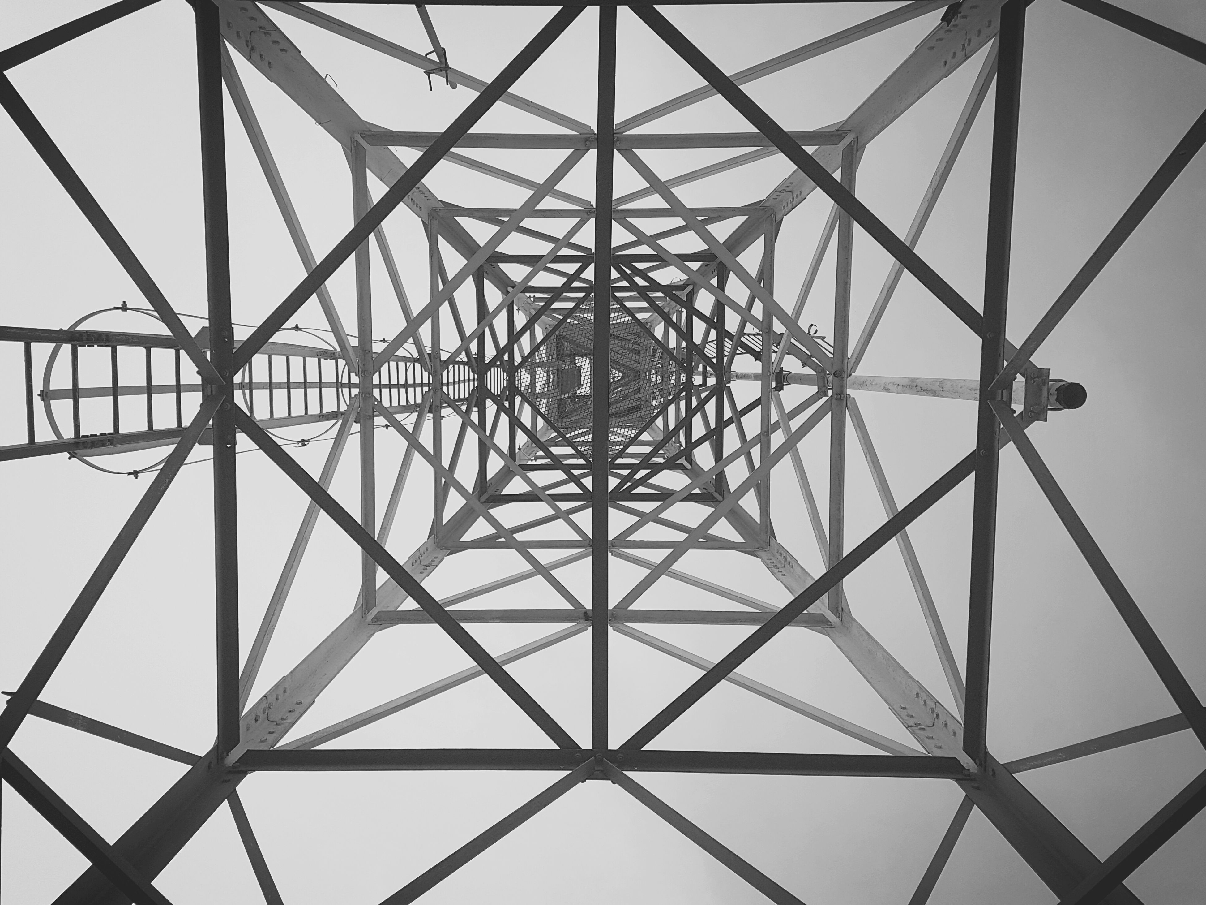 pattern, full frame, low angle view, backgrounds, no people, indoors, architecture, built structure, day, sky, symmetry, girder