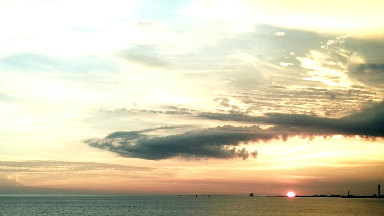 sea, sunset, sky, cloud - sky, water, horizon over water, scenics, nature, beauty in nature, sun, tranquil scene, tranquility, outdoors, silhouette, sunlight, no people, horizon, travel destinations, beach, nautical vessel, day