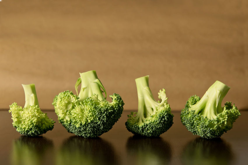 Broccoli pieces lined up in a row, on simple background - minimal vegetables Copy Space EyeEmNewHere EyeEmReady Floret Broccoli Brown Close-up Cut Vegetables Dark Background Food And Drink Fresh Freshness Green Color Greens Healthy Eating Indoors  Minimal Minimalism Neutral Background No People Rows Of Things Still Life Studio Shot Table Vegetables