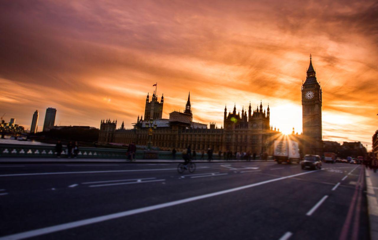 sunset, architecture, orange color, built structure, clock tower, building exterior, sky, travel destinations, cloud - sky, road, city, outdoors, cityscape, no people, day