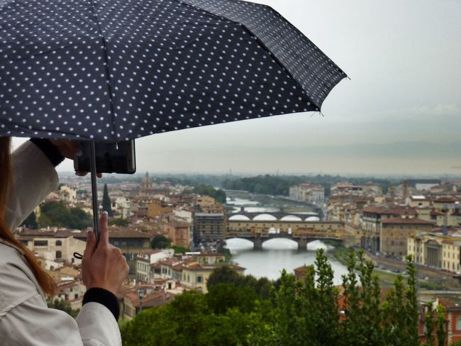 Taking photo with a smartphone from travel destination to send home Cityscape Outdoors City Building Exterior Architecture Built_Structure One Person Human Hand Close-up Human Body Part Eyem Gallery EyeEm Gallery Rainy Day Umbrella Cropped Object Florence Florenz/Firenze View From Plaza Michelangelo Smartphone Mobile Conversations Ponte Vecchio From Pizza Michelangelo Neighborhood Map Let's Go Smarter Let's Go. Together. Your Ticket To Europe Been There. An Eye For Travel