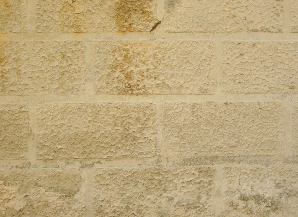 ArchiTexture Background Textures And Surfaces Old Wall Yellow Ocher Ashlared Bossy Weathered Stained