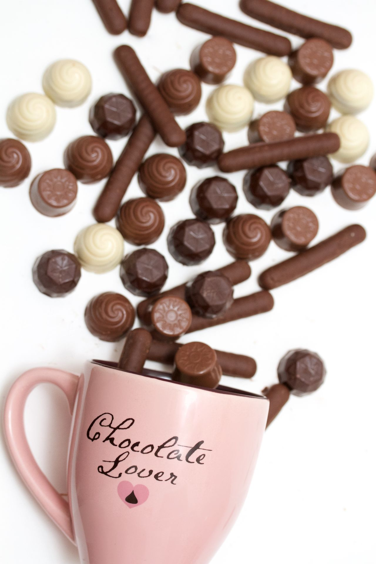 chocolate truffles and a pink mug on white background Chocolate Close-up Large Group Of Objects No People Pink Pink Mug Truffles White Background