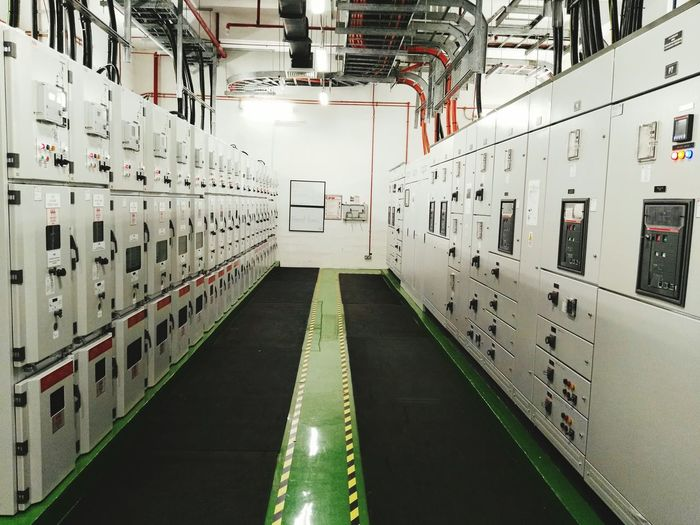 HT Switch Gear Room. Electrical Safety. Safety First. Location Factory At Penang, Malaysia. HT Switch Gear Room Room Ducting Insulated Carpet Yellow Black Tape Green Black Nopeople Lights Light Lux Lighting Equipment Electricity  High Voltage High Voltage Sign Electrical High Voltage Indoors  Locker Industry No People Factory