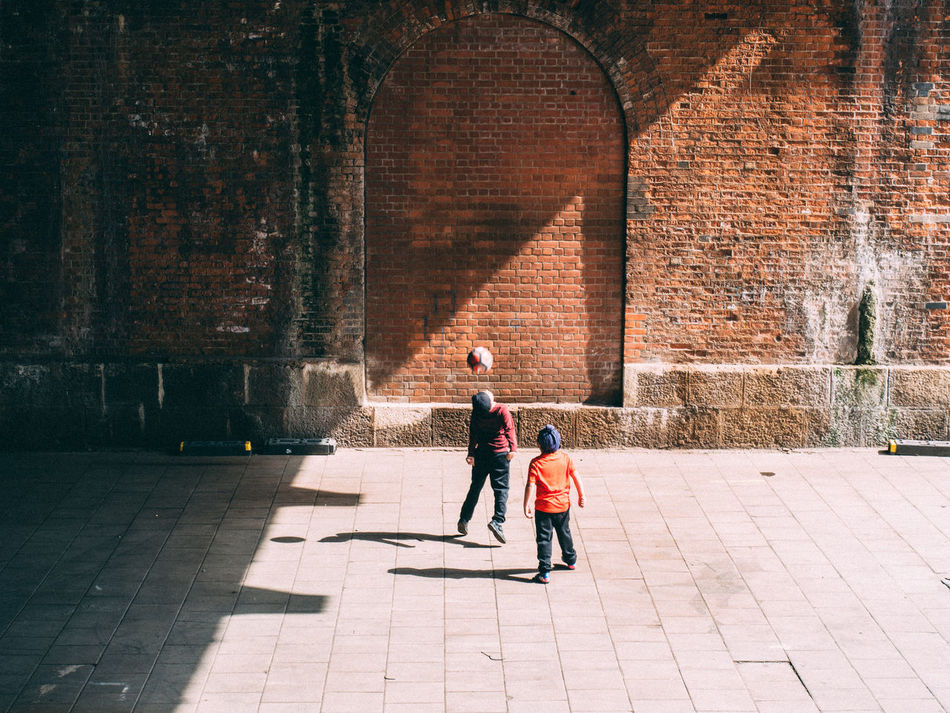 Architecture Bonding Boys Brick Wall Built Structure Childhood City Day EyeEm Diversity Full Length Lifestyles Outdoors People Real People Shadow Sunlight Togetherness Two People