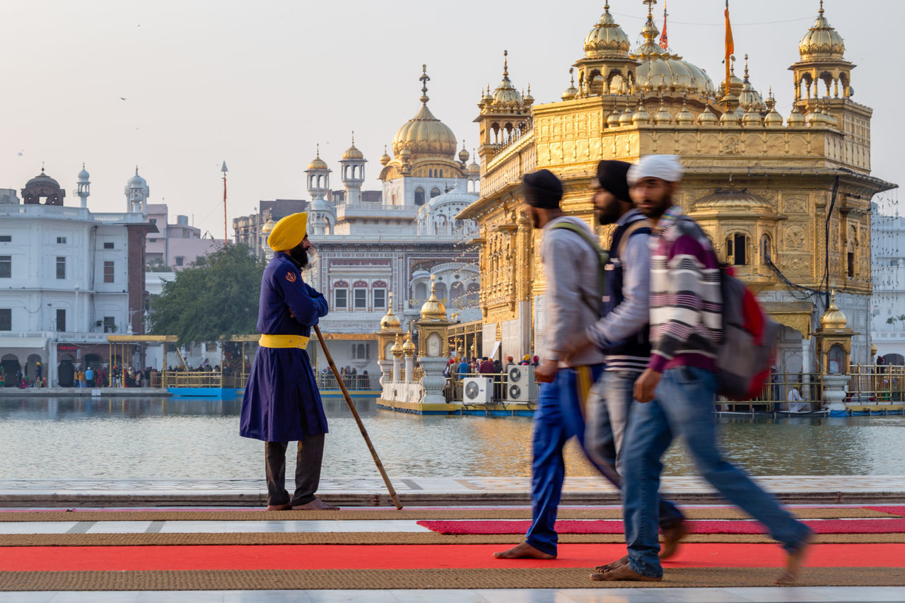 Sikh Guard at the Golden Temple, Harmandir Sahib, in Amritsar, India Amritsar Architecture Blurred Built Structure Golden Golden Temple Guard Harmandir Sahib Headwear India Outdoors People Punjab Security Sikh Sikhism Temple Traditional Clothing Travel Destinations Turban