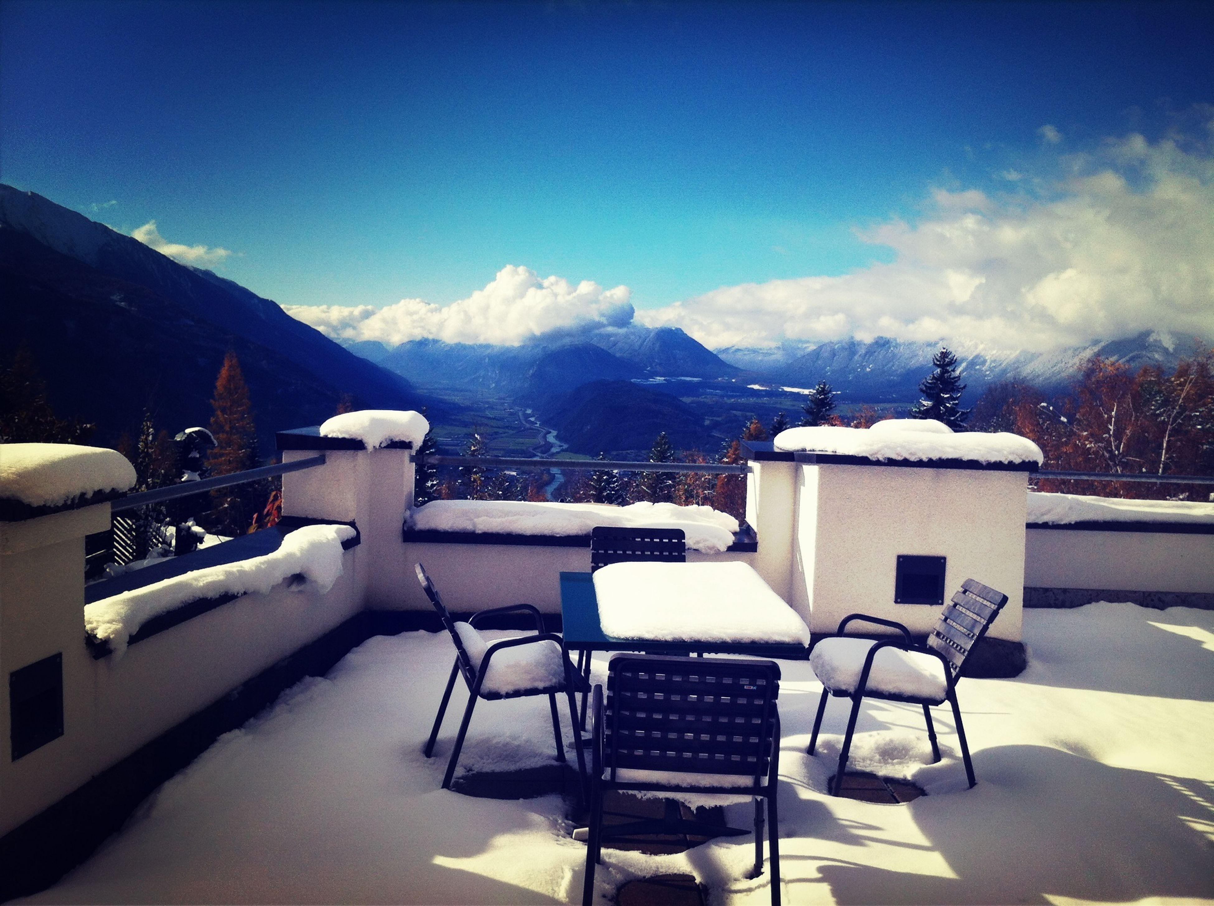 mountain, mountain range, sky, chair, building exterior, snow, architecture, built structure, table, tranquility, nature, empty, tranquil scene, absence, house, winter, cold temperature, scenics, landscape, beauty in nature