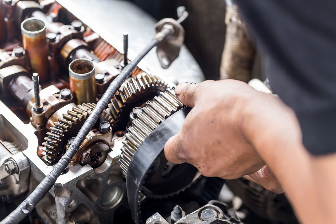 The car engine fixing by technician. Adult Adults Only Business Finance And Industry Close-up Day Engine Holding Human Body Part Human Hand Indoors  Men Occupation One Man Only One Person Only Men People Real People Repairing Skill  Small Business Working Workshop
