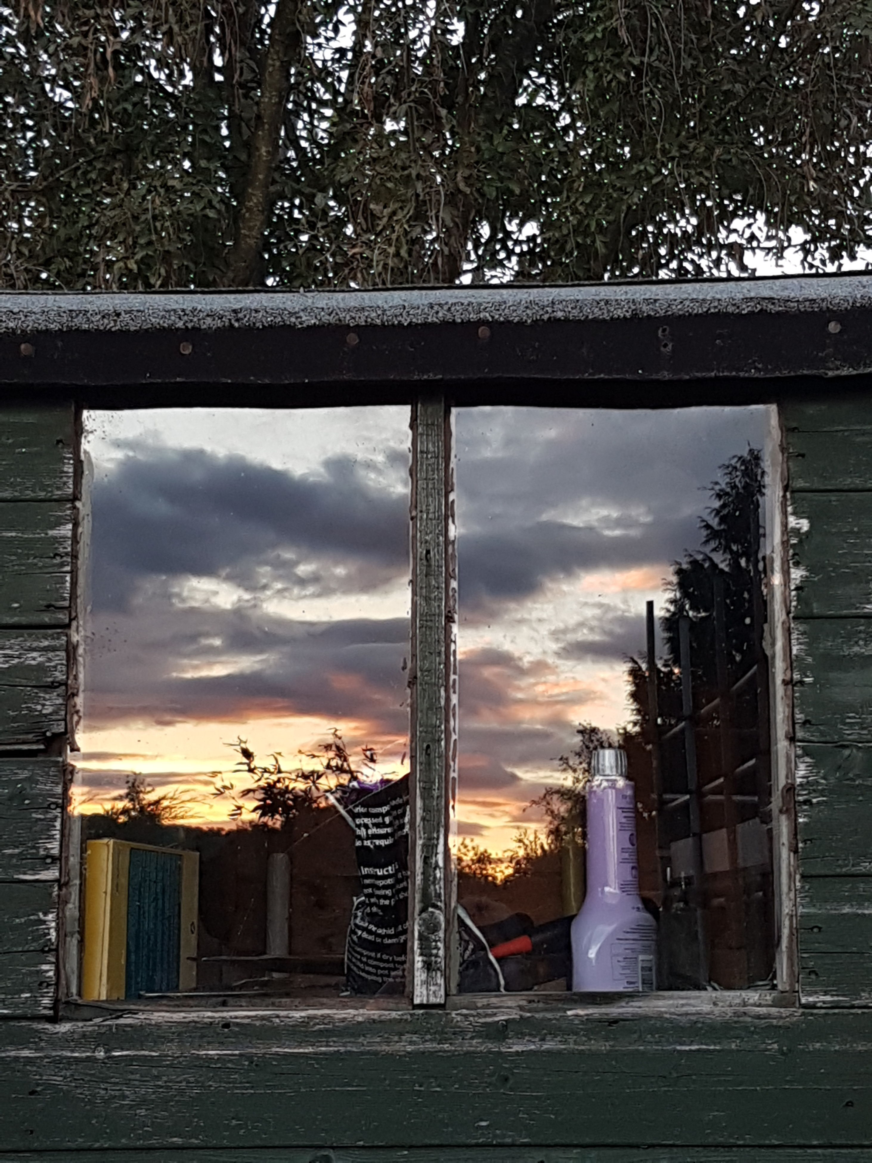 built structure, architecture, building exterior, tree, sunset, entrance, outdoors, architectural column, orange color, sky, cloud - sky, no people, facade
