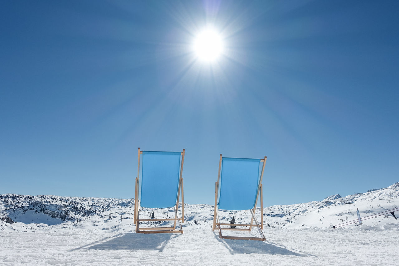 Take a seat... Beauty In Nature Blue Chair Cold Temperature Day Deck Chair Nature Outdoors Relaxing Sky Snow Sun Sunbeam Sunlight Sunny Tranquil Scene Tranquility Winter Bright