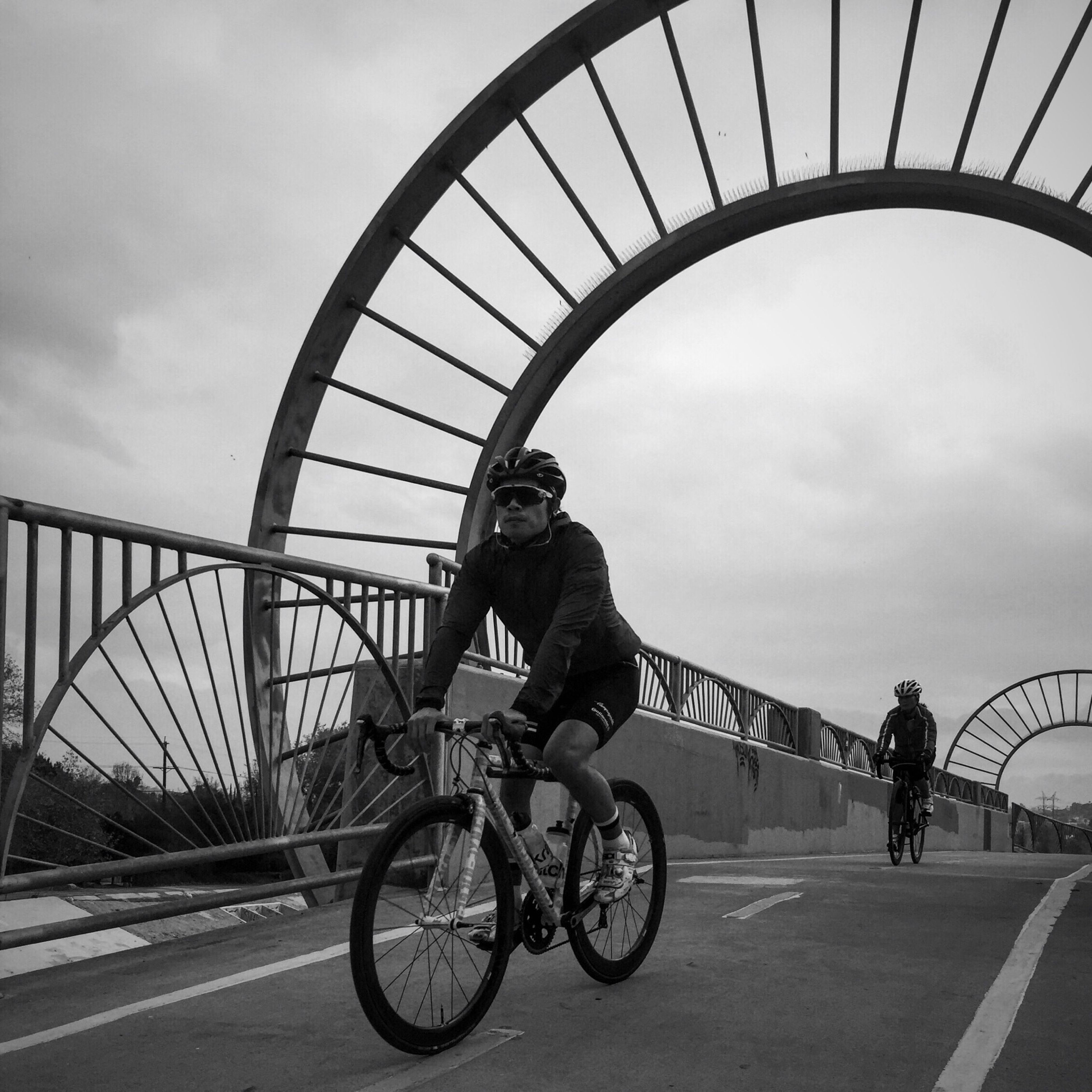 bicycle, transportation, lifestyles, leisure activity, riding, sky, mode of transport, full length, men, land vehicle, cycling, cloud - sky, architecture, built structure, travel, road, day, standing