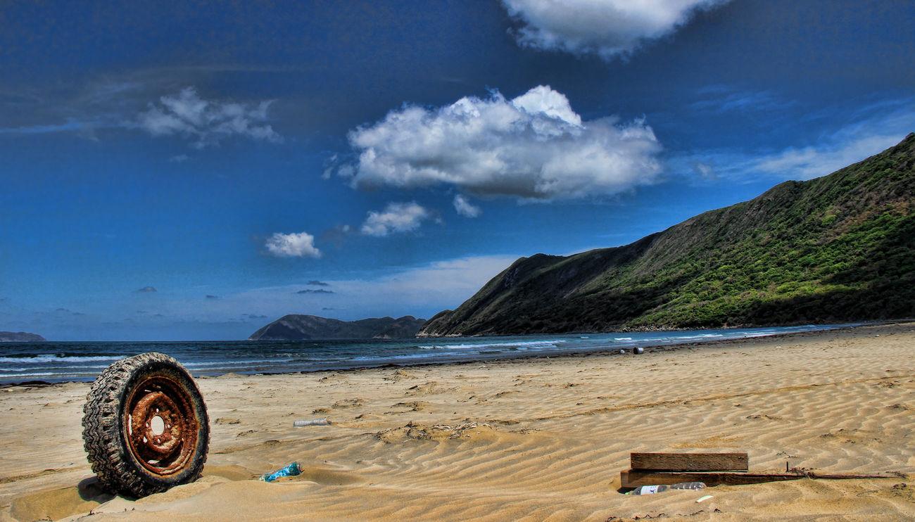 Beach Beachphotography Beauty In Nature Cloud - Sky Island Mountain Nature Sand Scenics Sea Sky Tire Tranquility Trash Vietnam Trip Vietnamphotography Water Wheel