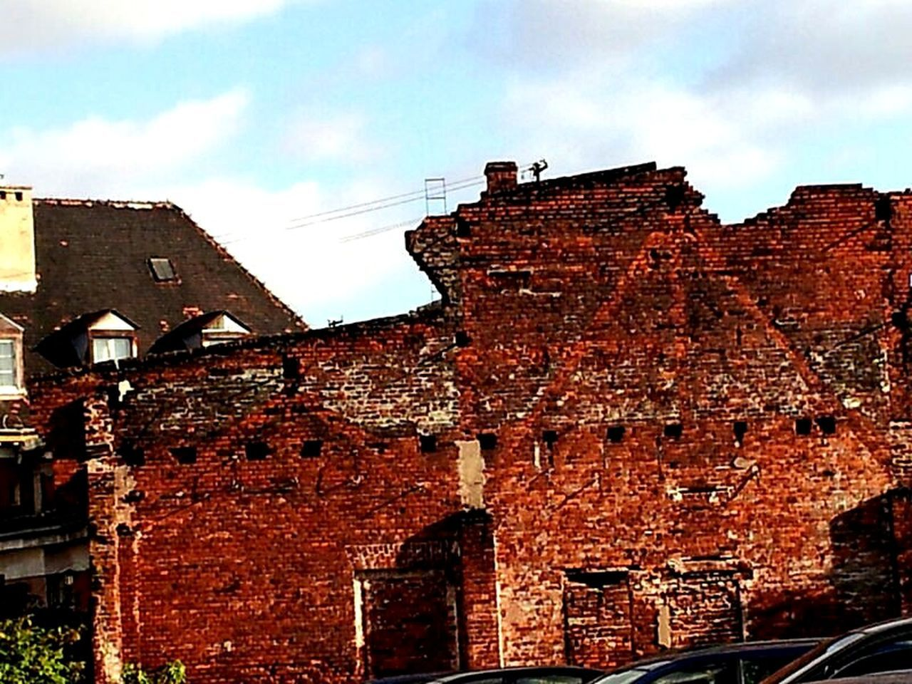 architecture, built structure, building exterior, cloud - sky, brick wall, sky, low angle view, no people, day, red, abandoned, outdoors
