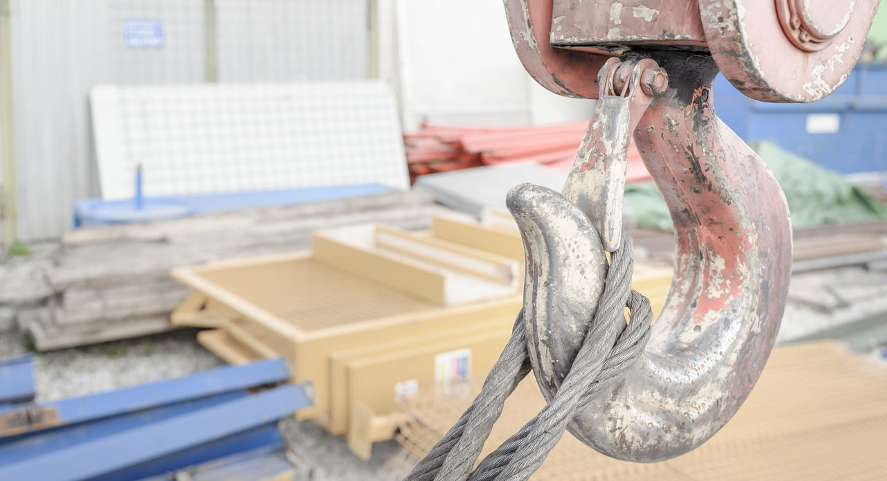A close up of the hook on a crane. Close-up Construction Crane Hook Indutrialvisit Love Tool