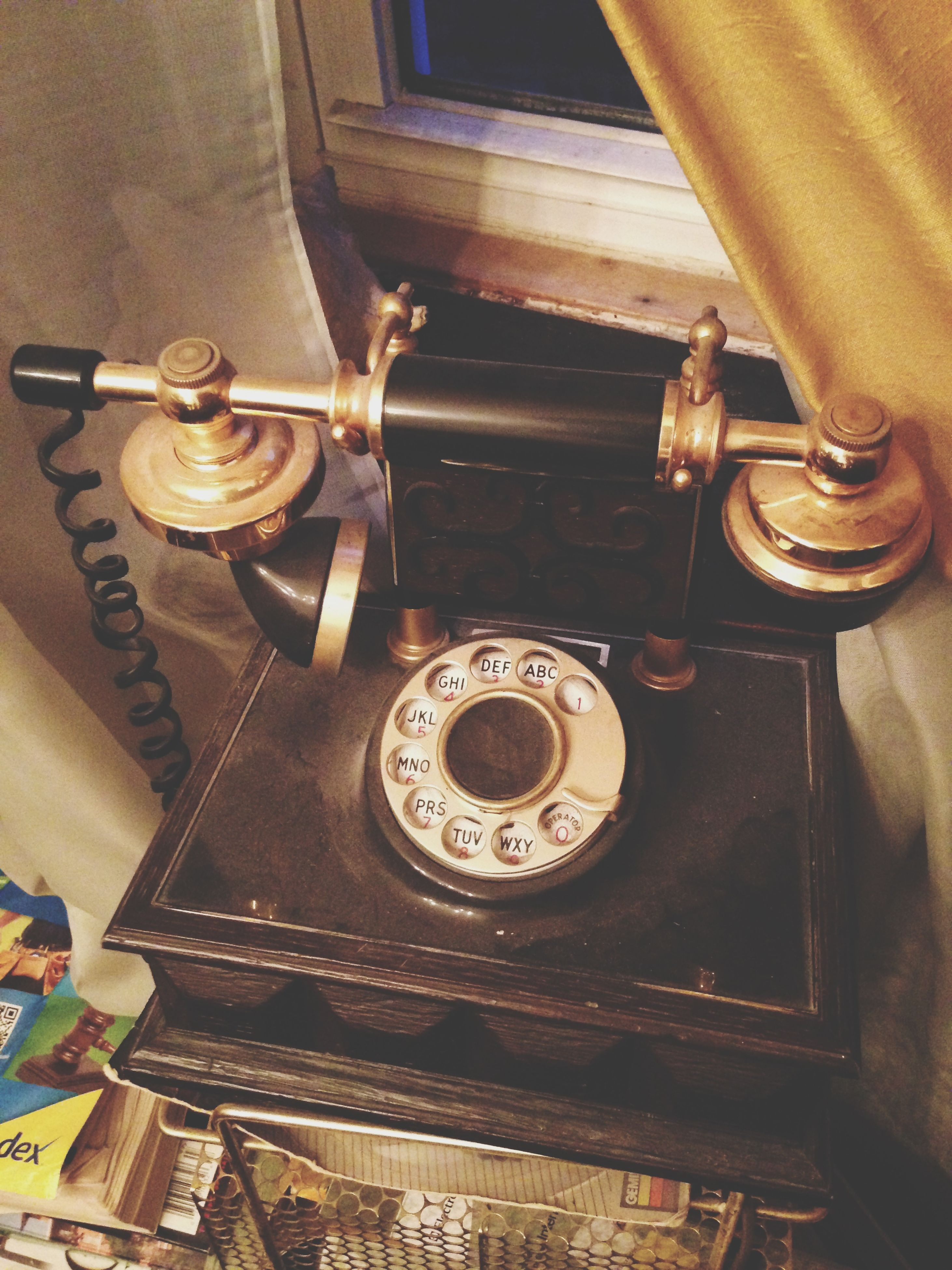 indoors, technology, old-fashioned, retro styled, metal, antique, close-up, connection, old, still life, telephone, equipment, table, communication, machinery, number, high angle view, machine part, vintage, metallic