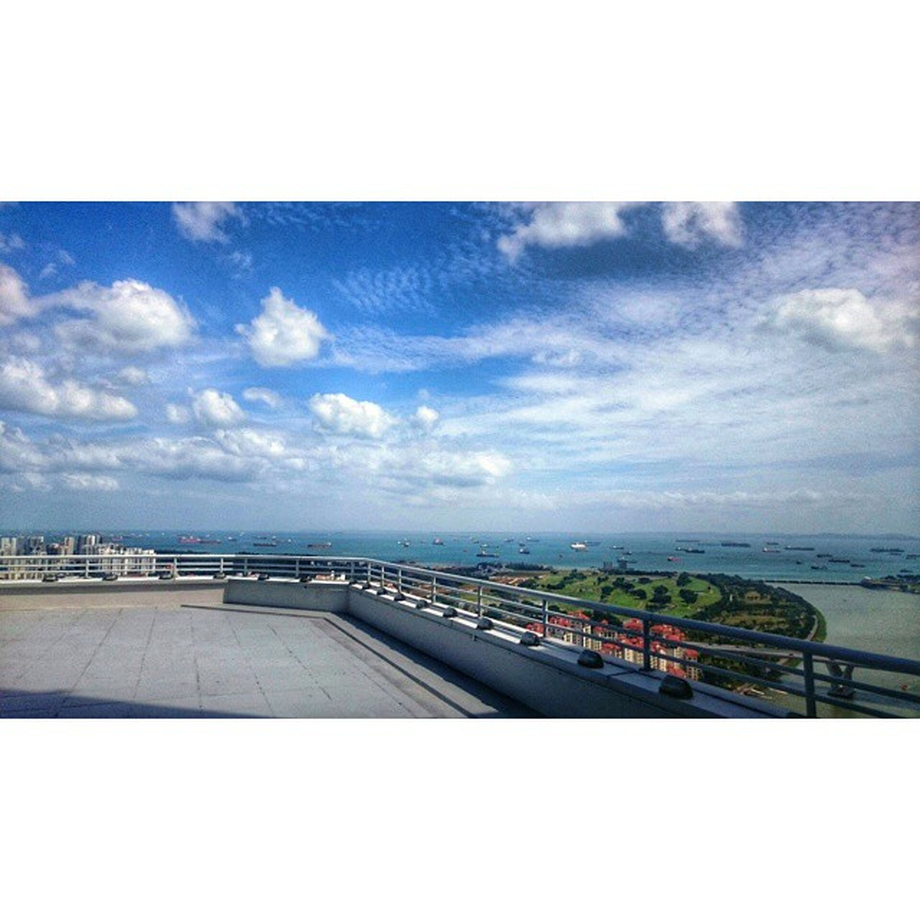 sky, transportation, cloud - sky, the way forward, cloudy, cloud, road, transfer print, diminishing perspective, road marking, sea, auto post production filter, horizon over water, vanishing point, landscape, day, nature, mode of transport, outdoors, horizon over land
