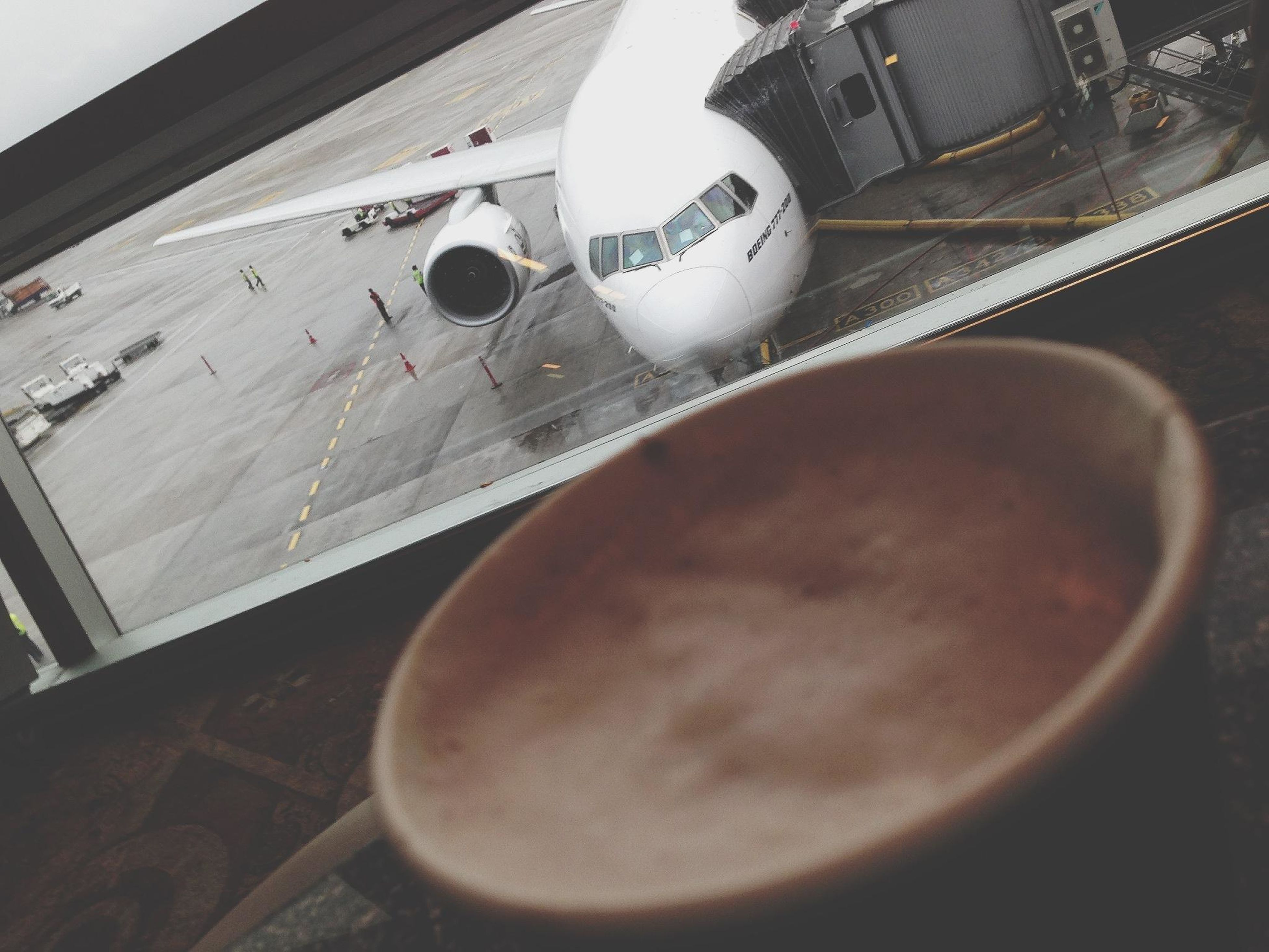 indoors, close-up, transportation, part of, air vehicle, high angle view, technology, table, airplane, mode of transport, reflection, glass - material, no people, metal, cropped, communication, day, still life, number, window