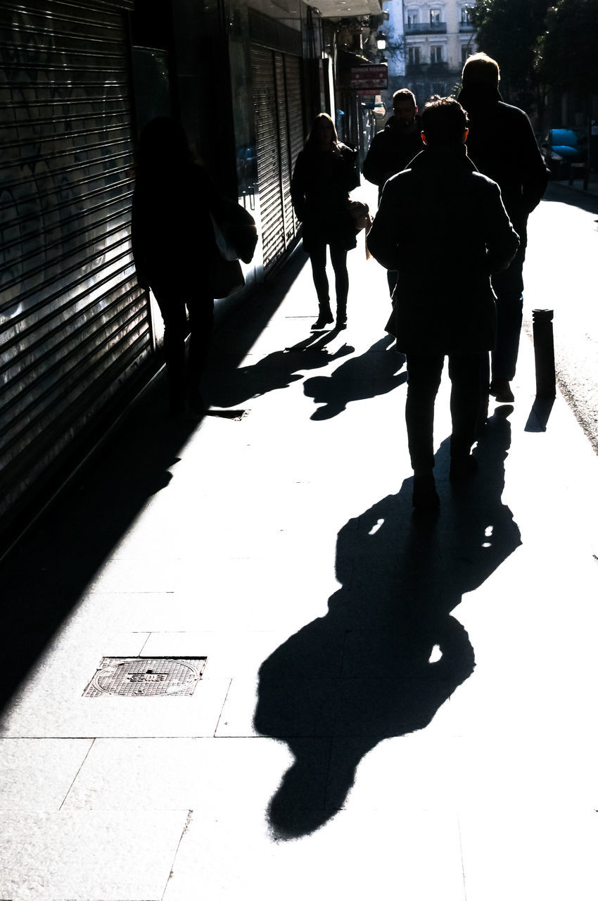 shadow, real people, men, sunlight, full length, women, walking, day, silhouette, lifestyles, outdoors, adult, people