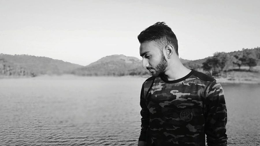 Thoughts all around. Landscape Candid Portrait Bnw Monochrome Scenics Lake One Person Beard Outdoors Sky