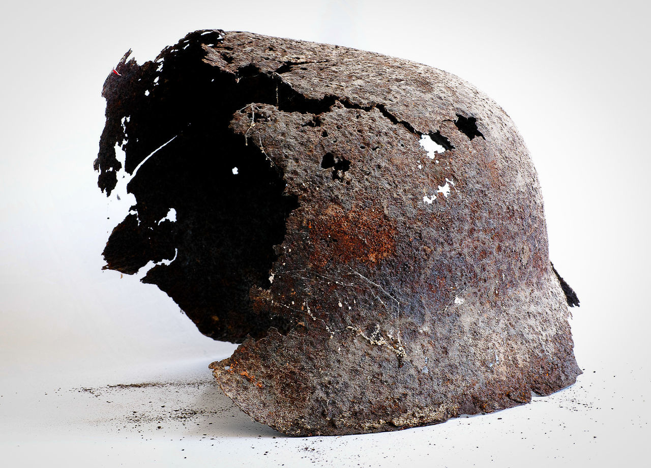 Found this remains of a soldier´s helmet on a construction site next to my house, made photo at home and threw it away. Destruction Helmet History Object Object Photography Rusty Metal Textured  War
