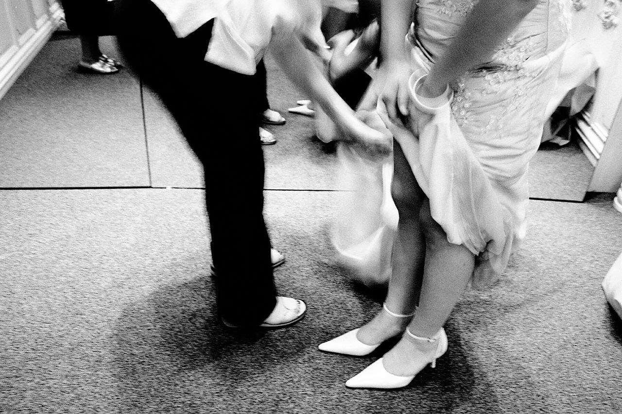 Bride hurrying. Human Leg Indoors  Human Body Part Real People EyeEmNewHere The Week On EyeEm Mix Yourself A Good Time Portraits PortraitPhotography Analogue Photograhy Filmsnotdead 35mm Film Photography BW_photography Noir Et Blanc Filmisalive Black & White Photography Bridal Portrait Hurrying Hurry Up! Skirt Getting Ready Weddings Around The World Marriage Ceremony EyeEm Gallery Feet And Shoes Black And White Friday Be. Ready.