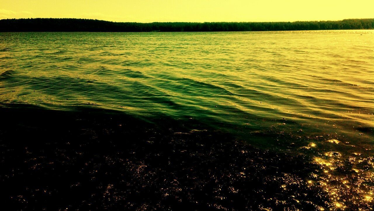nature, tranquility, tranquil scene, beauty in nature, water, scenics, no people, outdoors, lake, rippled, landscape, holiday, day, grass, sky