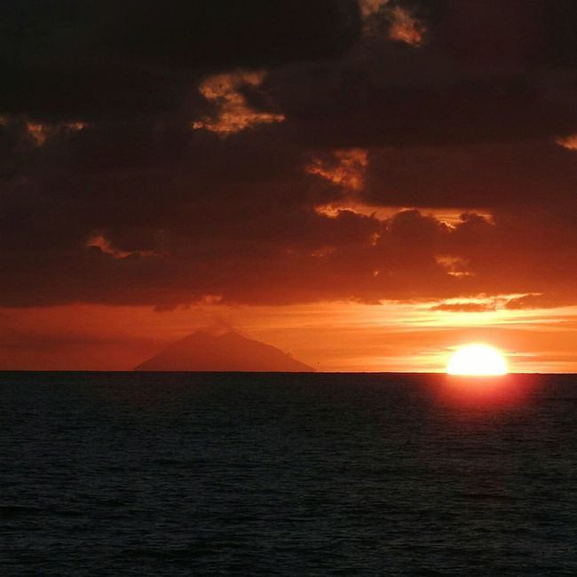 Sunset from the calabrian coast with view of volcano Stromboli Sunset Scenics Sea Beauty In Nature Dramatic Sky Reflection Tranquil Scene Horizon Over Water Cloud - Sky Sun Nature No People Silhouette Water Orange Color Taking Pictures Taking Photos Sky Silhouette Photography Orange Sunset Stromboli Volcano Volgocalabria Sunsets Calabria South Italy EyeEm Nature Lover