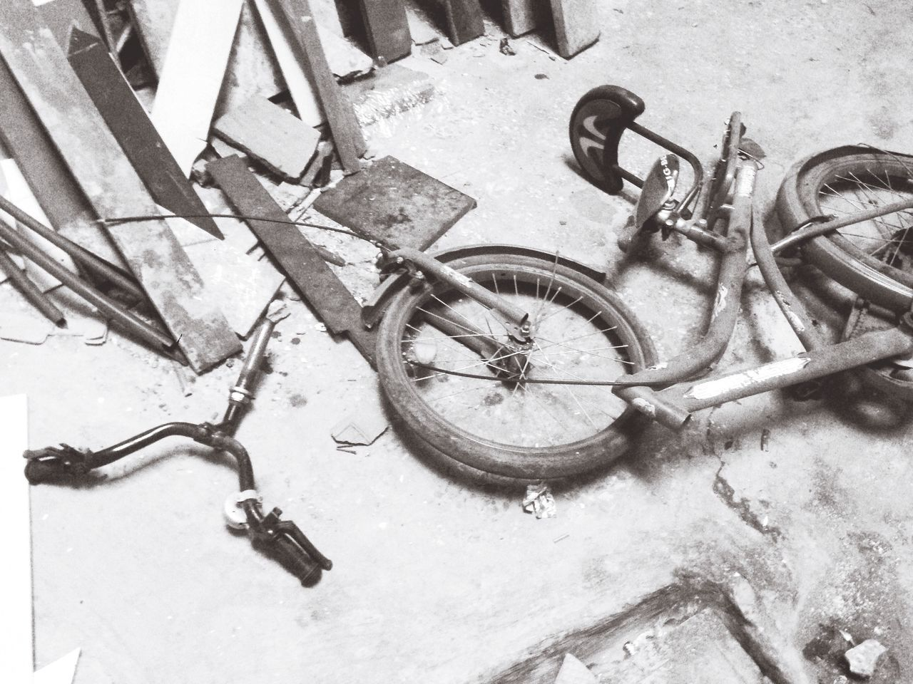 High Angle View Of Damaged Bicycle In Abandoned House