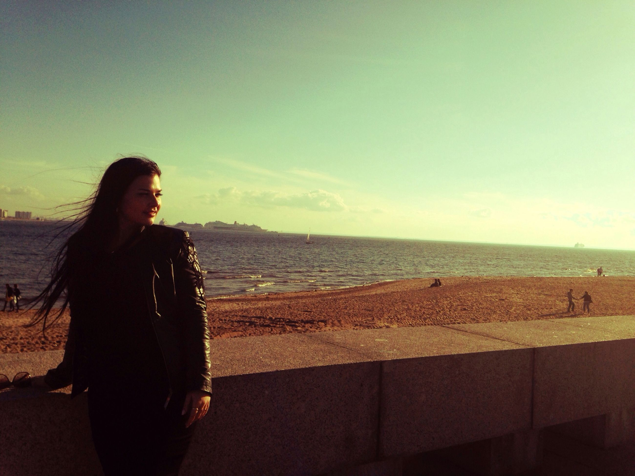 young adult, lifestyles, young women, leisure activity, sea, person, standing, horizon over water, casual clothing, sky, water, long hair, portrait, looking at camera, waist up, beach, scenics, looking at view