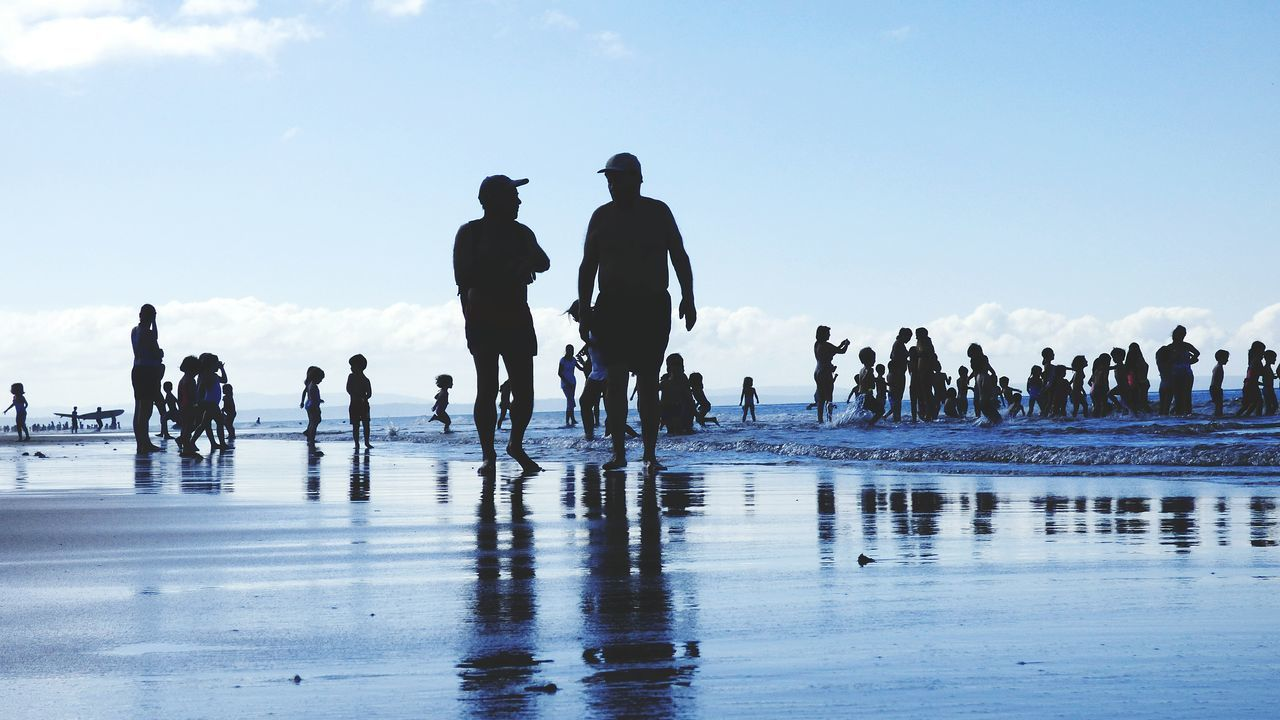 Seaside Large Group Of People Outdoors Sea Day People Sky Water Children Playing On Beach Vacation Time Togetherness Beach Life Leisure Activity Wave Silhouette Beach Standing Wet Fun Vacations Water's Edge