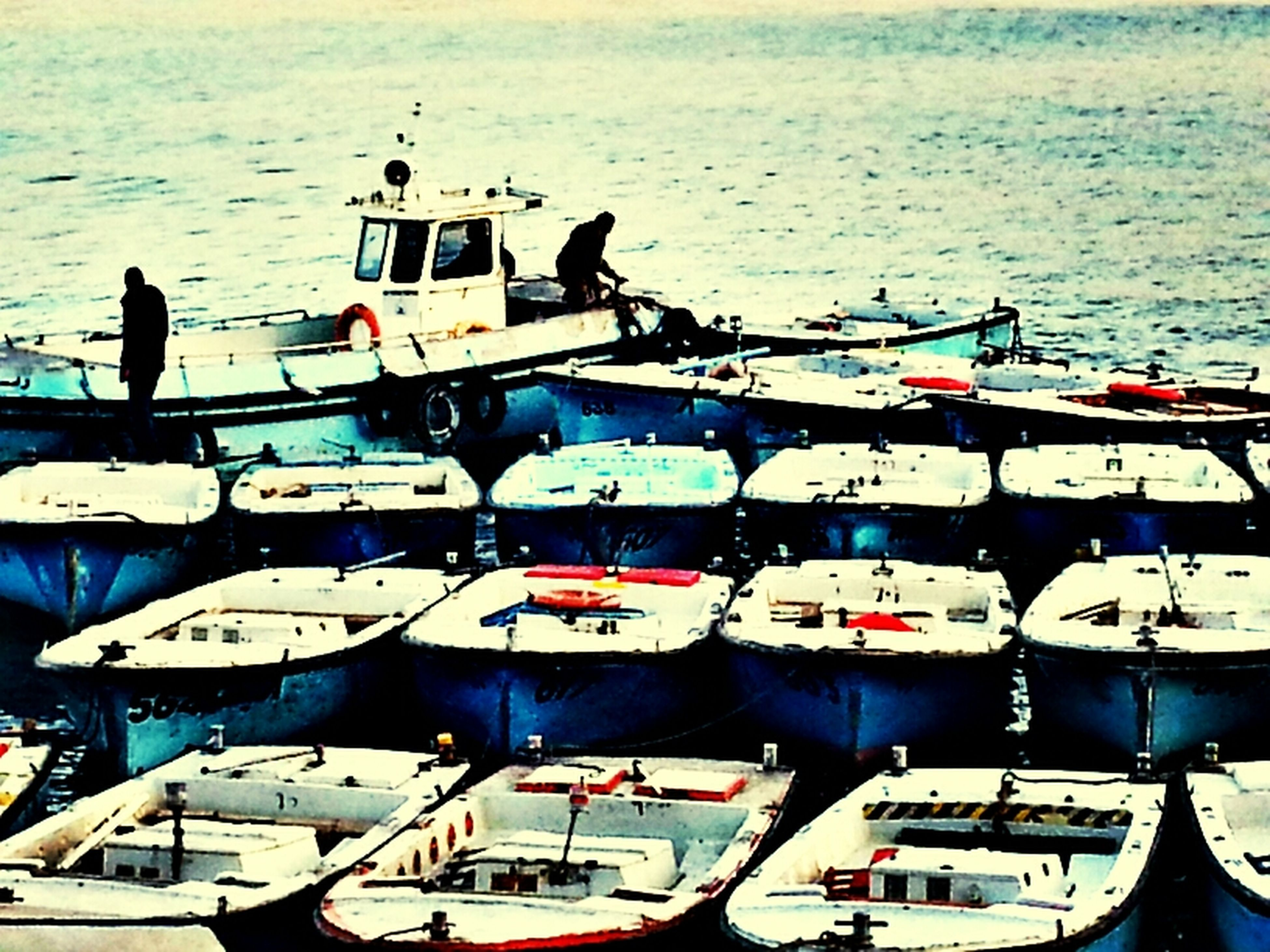 nautical vessel, transportation, boat, moored, mode of transport, water, sea, in a row, high angle view, travel, harbor, day, large group of objects, outdoors, side by side, nature, blue, abundance, no people, group of objects