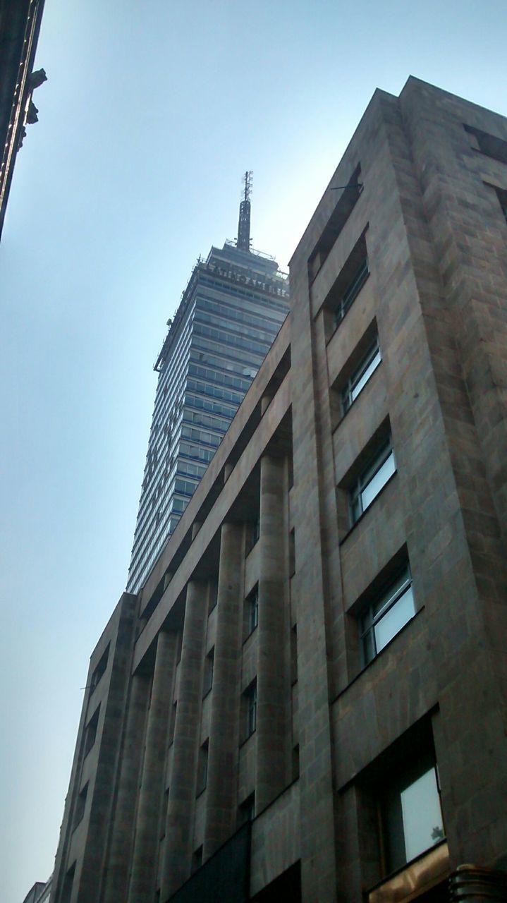 architecture, building exterior, built structure, modern, low angle view, skyscraper, tower, city, day, sky, no people, outdoors