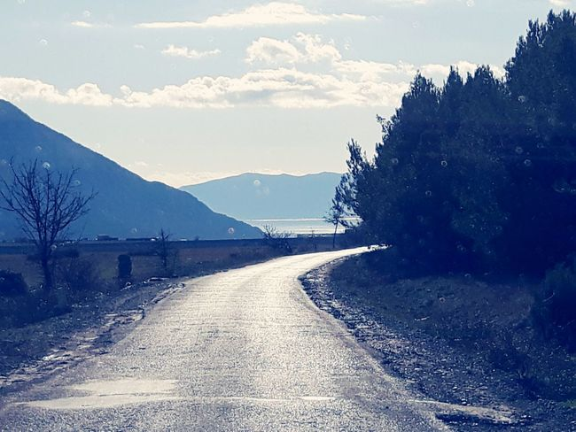 Road Winter Outdoors Mountain Cloud - Sky Cold Temperature Sky Landscape No People Nature Day Scenics Tree Beauty In Nature An Eye For Travel