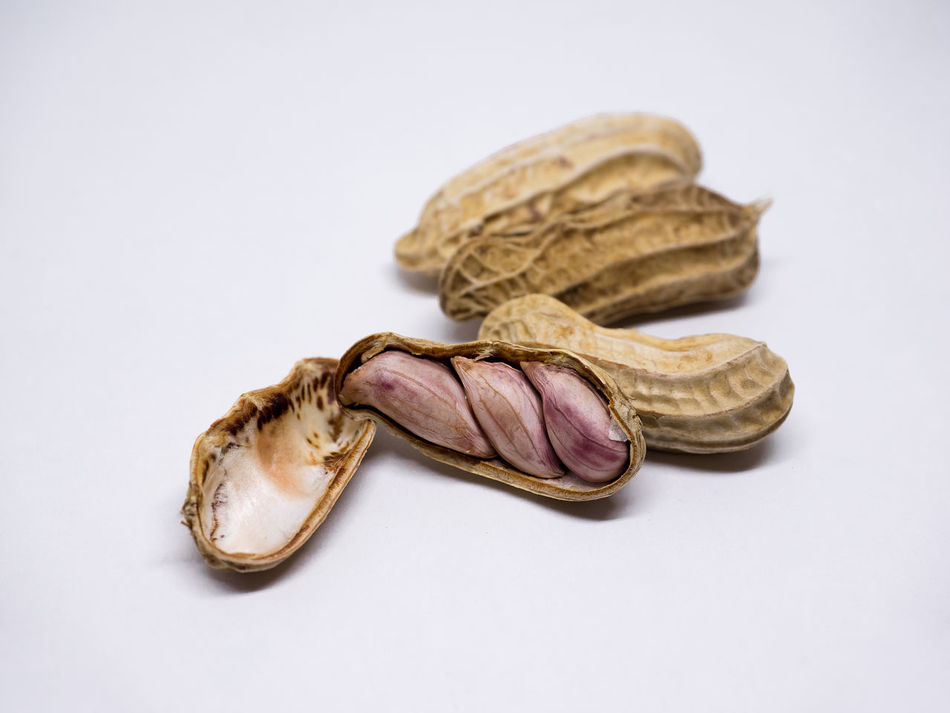 Fresh Peanuts in closeup. Peanuts in shell and peeled isolated on white background. Close-up Day Fat Food Food And Drink Fresh Freshness Healthy Eating Indoors  Isolated Jelly Low Angle View No People Nut Nut - Food Nutshell Open Organic Peanuts Plant Pod Seed Snack Still Life Studio Shot White Background