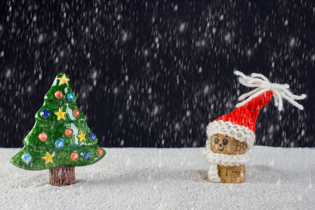 puppets with Christmas-hats and snow falling from the sky Background Cap Card Celebration Christmas Claus December Festive Holiday Merry Red Santa Sky Snow Tree White Winter Xmas