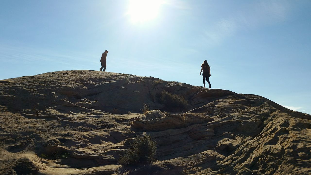 Reaching for the sun Moab, Utah Rock Formations Beauty In Nature Two People One Woman Only Rock Formation Physical Geography Mountain Sunlight Sun Streaks Geology Live For The Story