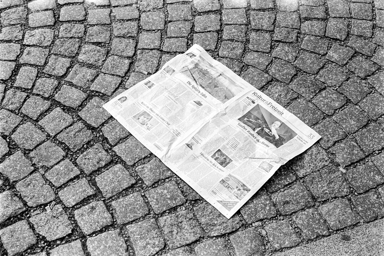 Location: Demianiplatz Canon A-1 P | APX 100 -> 50 | D-76 AgfaPhoto APX 100 (new) Black And White Blackandwhite Canon A-1 Cobblestone EyeEm Best Shots - Black + White Kodak D-76 Monochrome Newspaper