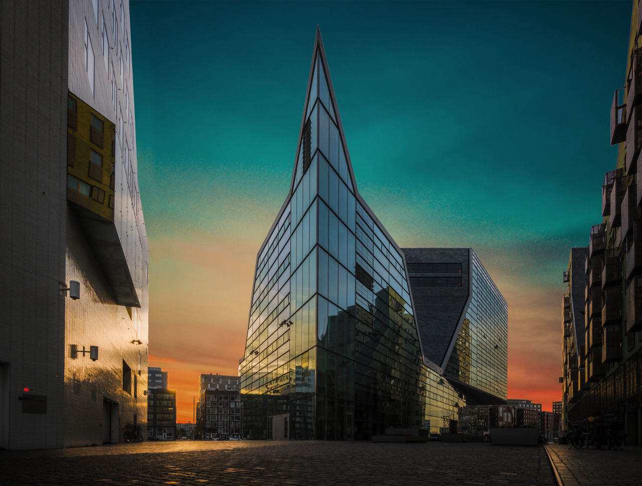architecture, building exterior, built structure, sky, city, skyscraper, outdoors, sunset, no people, modern, day