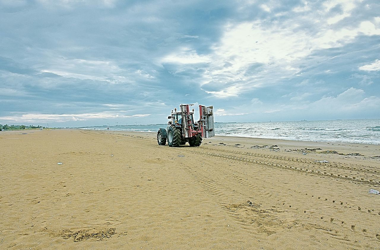 sand, beach, transportation, cloud - sky, mode of transport, sea, sky, land vehicle, nature, horizon over water, day, outdoors, beauty in nature, water, sand dune, no people