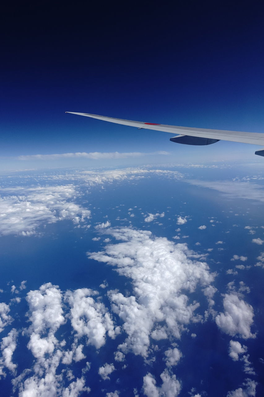 airplane, blue, transportation, sky, no people, aerial view, journey, air vehicle, mode of transport, travel, cloud - sky, flying, nature, airplane wing, outdoors, day, mid-air, beauty in nature