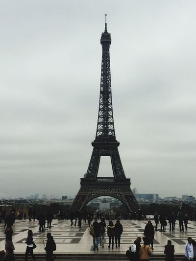 Paris Paris, France  Paris By Day Eiffel Tower Famous Place Tourism International Landmark Travel Destinations Tower Architecture Large Group Of People Built Structure Capital Cities  Travel Tourist Culture Person Tall Tall - High Sky City Full Length Vacations Romance Romantic City