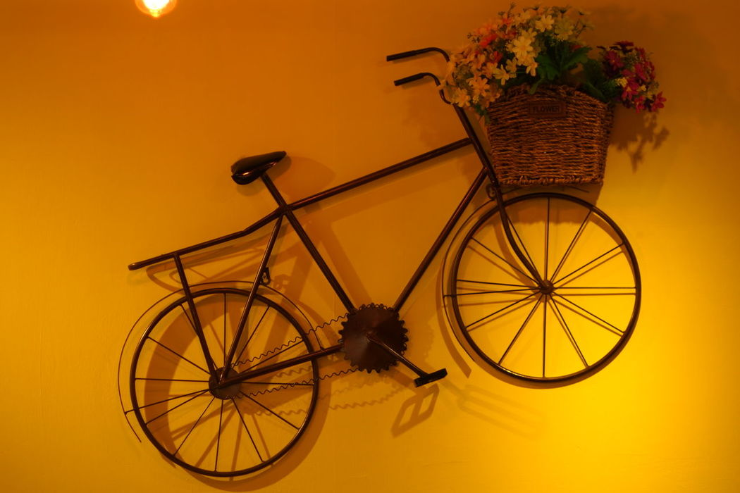 Purist No Edit No Filter Break The Mold Art Is Everywhere Indoors  Colored Background Warm Yellow Antique Bike On The Wall
