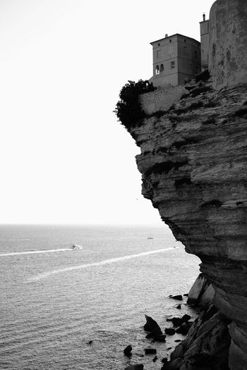 The Rock of the Old Town Black & White Cityscape Fujifilm X-E2 Rock Architecture Beauty In Nature Black And White Blackandwhite Building Exterior Built Structure Clear Sky Cliff Day Fujifilm_xseries Horizon Over Water Nature No People Outdoors Rocks Scenics Sea Sea And Sky Sky Sky_collection Water