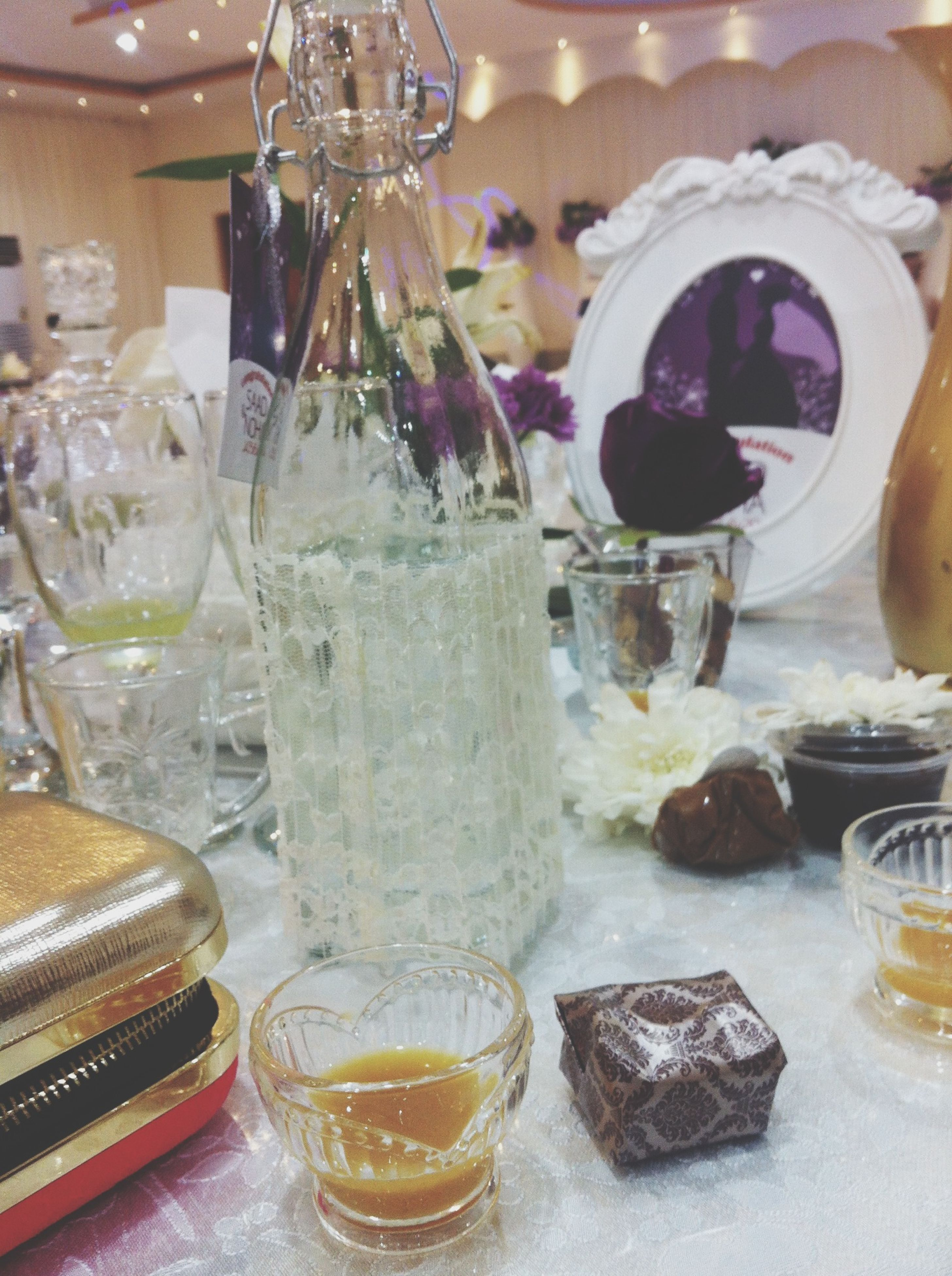 food and drink, indoors, freshness, drinking glass, drink, refreshment, glass - material, table, food, still life, transparent, close-up, ready-to-eat, indulgence, wineglass, sweet food, restaurant, glass, alcohol, incidental people