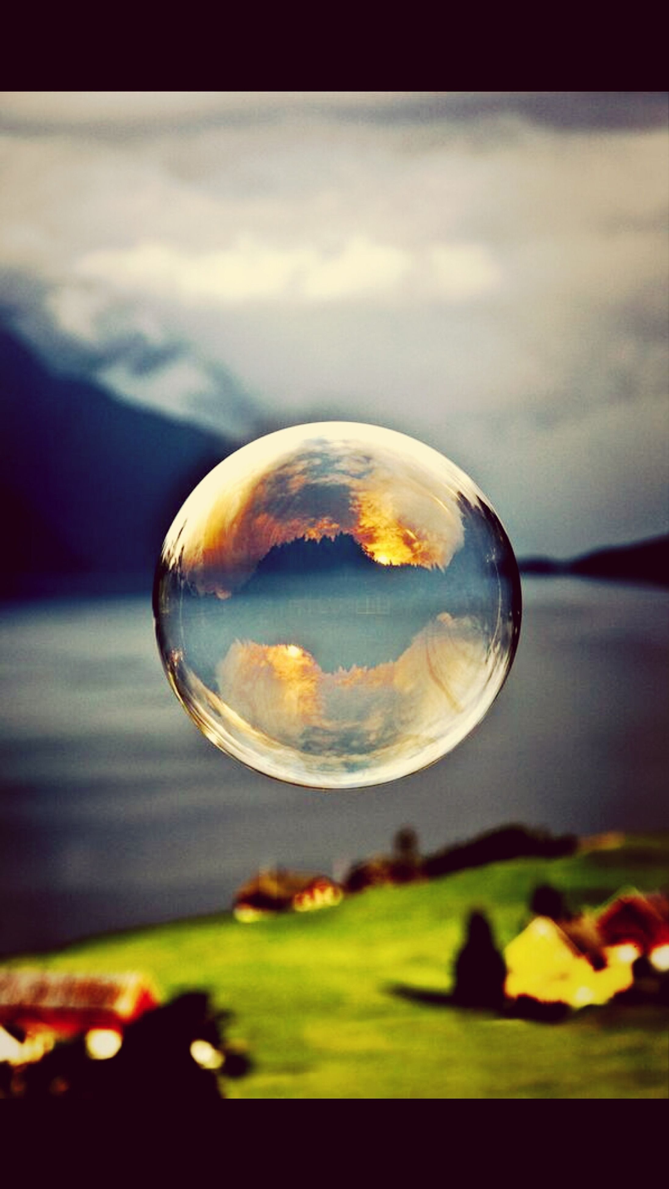 transparent, close-up, focus on foreground, sky, sphere, glass - material, reflection, fragility, nature, water, beauty in nature, drop, cloud - sky, bubble, tree, circle, selective focus, tranquil scene, no people, tranquility