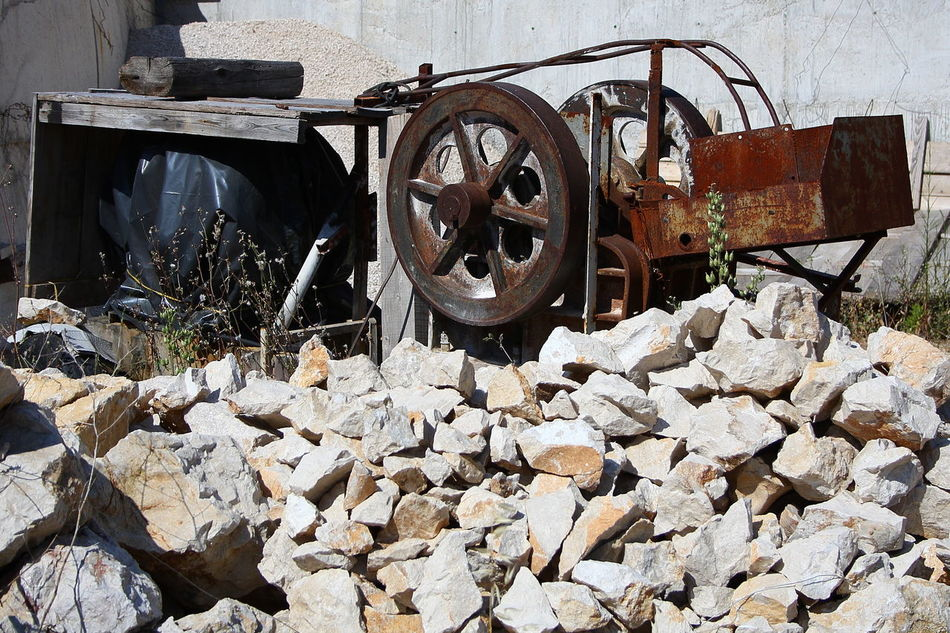 Work Horse Abandoned Cog Croatia Damaged Destruction Dry Stone Dry Stone Wall Dry Stone Walls Iron Machinery Obsolete Old Pile Of Stones Quarries Quarry QuarryRock Rock Ruined Rust Rusty Stone Stone - Object Stone Wall Wall Wheel