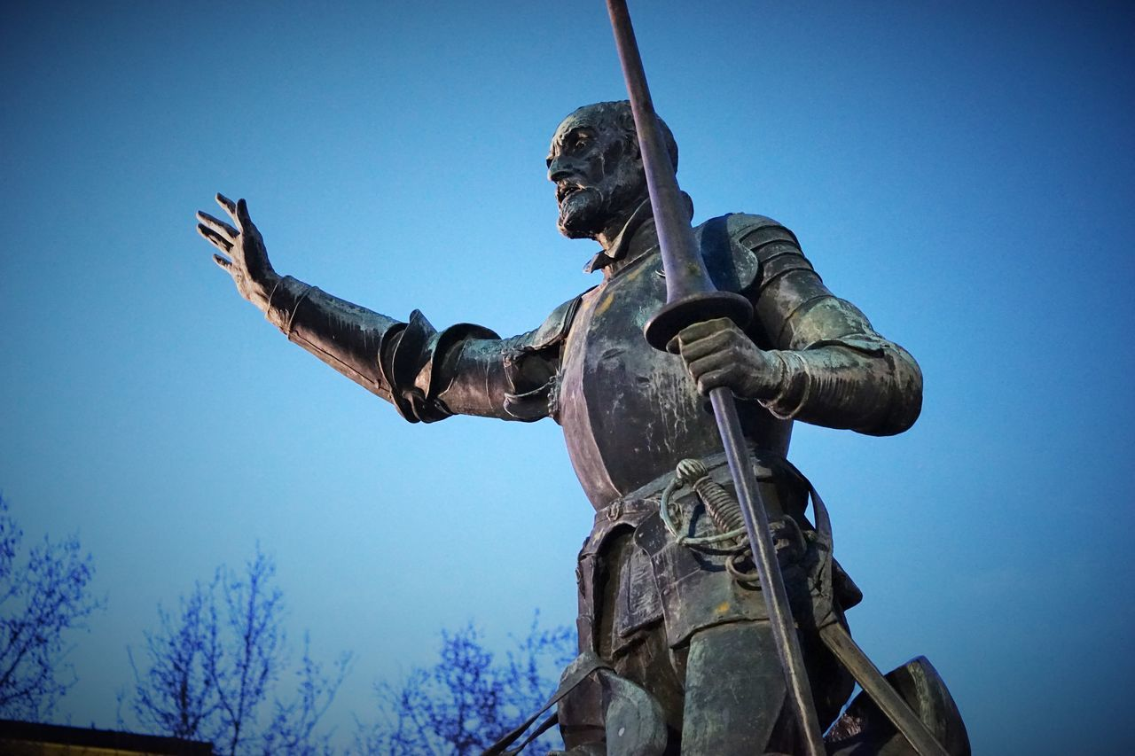 Architecture Art And Craft Bronze - Alloy Day Human Representation Low Angle View Male Likeness Monument No People Outdoors Sculpture Shield Sky Statue Suit Of Armor Sword Warrior - Person